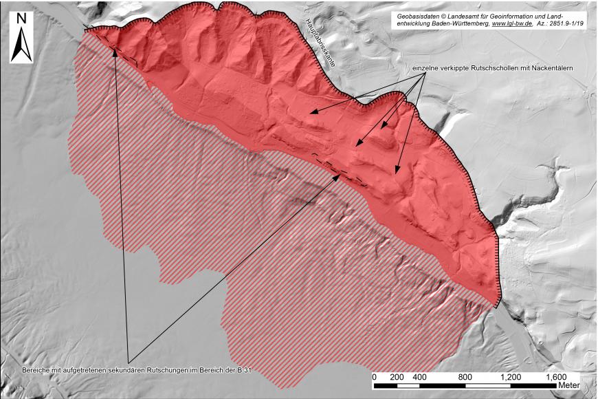 Aufsicht auf eine Reliefkarte in Graustufen, in welche ein Rutschungsgebiet mit einer roten Fläche eingezeichnet ist.