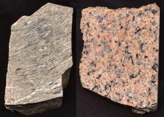 Großaufnahme zweier Steine: Der Stein links ist grau marmoriert und erscheint eher glatt, der Stein rechts ist rosa und hat graue und schwarze Einschlüsse.